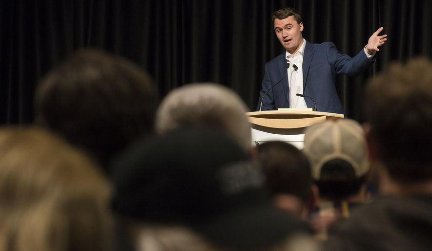 In this Friday, Feb 2, 2018, photo conservative activist Charlie Kirk, a speaker with Turning Point USA gives his speech at the Lory Student Center on campus at Colorado State University in Fort Collins, Colo. Police broke up a crowd of about 200 demonstrators at the university after a group arrived armed with bats and shields. Campus police say there were no arrests at the demonstration late Friday. (Timothy Hurst/The Coloradoan via AP)
