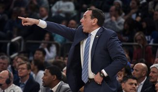 Duke's coach Mike Krzyzewski shouts during the first half of an NCAA college basketball game against St. John's at Madison Square Garden in New York, Saturday, Feb. 3, 2018. St. John's defeated No. 4 Duke 81-77. (AP Photo/Andres Kudacki)