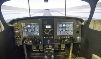 A Wednesday, Jan. 24, 2018 photo shows the cockpit area of the flight simulator at Outlaw Aviation in Sisters, Ore. (Ryan Brennecke/The Bulletin via AP)
