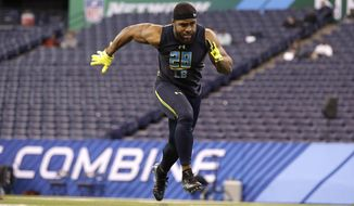 FILE - In this March 5, 2017 file photo, Northwestern linebacker Anthony Walker runs a drill at the NFL football scouting combine in Indianapolis. Walker plays in the NFL. He spent the last month in the NBA.The Indianapolis Colts linebacker started his offseason by spending four weeks as an intern with the Miami Heat, getting a crash course on how the basketball team from his hometown handles things from a business operations standpoint. The Heat exposed Walker to plenty, including how game nights work and the execution of off-site events.(AP Photo/David J. Phillip, File)