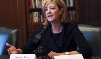 "FILE - In this Jan. 29, 2018 file photo, Rep. Jeanne Ives (42nd) meet with the Chicago Tribune Editorial Board at Tribune Tower in Chicago.   Ives, who is trying to unseat Illinois Gov. Bruce Rauner.  is standing by a campaign ad that's being blasted as racist, homophobic and ""repulsive.""   Ives, a social and fiscal conservative, says the ad that began airing this weekend illustrates the GOP governor's ""chosen constituents based on the policy choices he made."" The ad features actors portraying people including a transgender woman and a Chicago Teachers Union member, all thanking Rauner.(Jose M. Osorio/Chicago Tribune via AP)"
