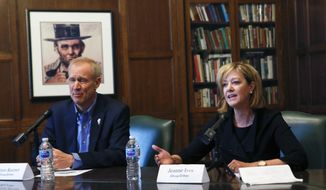 FILE - In this Jan. 29, 2018 file photo, Republican Gov. Bruce Rauner and primary challenger  state Rep. Jeanne Ives, meet with the Chicago Tribune Editorial Board in Chicago. Anyone who has driven across Illinois on crumbling highways, commuted on regularly delayed Metra trains or sat for hours on congested expressways knows the state's transportation system is in desperate need of an upgrade. But the candidates for governor have very different opinions on how to pay for it. (Jose M. Osorio/Chicago Tribune via AP File)/Chicago Tribune via AP)