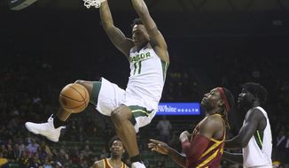 Baylor forward Mark Vital, left, scores past Iowa State forward Solomon Young, right, during the second half of an NCAA college basketball game, Saturday, Feb. 3, 2018, in Waco, Texas. Baylor won 81-67. (Michael Bancale/Waco Tribune-Herald via AP)