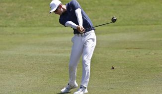 Dylan Frittelli ofSouth Africa strikes his ball on the 18th hole during the third round of the Maybank Championship golf tournament in Shah Alam, Malaysia, Saturday, Feb. 3, 2018. (AP Photo/Sadiq Asyraf)