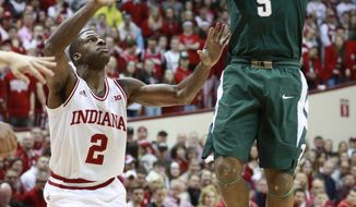 Michigan State guard Cassius Washington (5) shoots the basketball defended by Indiana guard Josh Newkirk in the first half of an NCAA college basketball game, Saturday, Feb. 3, 2018, in Bloomington, Ind. (AP Photo/R Brent Smith)