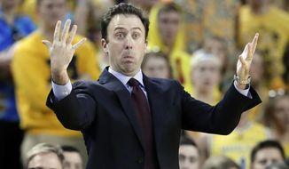 Minnesota head coach Richard Pitino gestures during the first half of an NCAA college basketball game against Michigan, Saturday, Feb. 3,2018, in Ann Arbor, Mich. (AP Photo/Carlos Osorio)