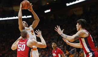 Tennessee forward Grant Williams (2) shoots a basket between Mississippi forward Justas Furmanavicius (50) and Mississippi center Dominik Olejniczak, right, in the first half of an NCAA college basketball game Saturday, Feb. 3, 2018, in Knoxville, Tenn. (AP Photo/Crystal LoGiudice)