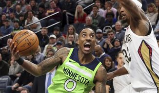 Minnesota Timberwolves' Jeff Teague, left, drives around New Orleans Pelicans' Dante Cunningham in the first half of an NBA basketball game Saturday, Feb. 3, 2018, in Minneapolis. (AP Photo/Jim Mone)