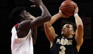 Purdue guard Carsen Edwards (3) shoots over Rutgers forward Mamadou Doucoure during the first half of an NCAA college basketball game Saturday, Feb. 3, 2018, in Piscataway, N.J. (AP Photo/Adam Hunger)