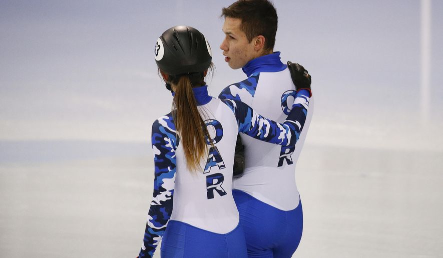 Wearing Olympic uniforms with the logo OAR - Olympic Athlete from Russia, Russian short track speed skaters Pavel Sitnikova, right, chats with Ekaterina Efremenkova during a training session prior to the 2018 Winter Olympics in Gangneung, South Korea, Saturday, Feb. 3, 2018. (AP Photo/Jae C. Hong)