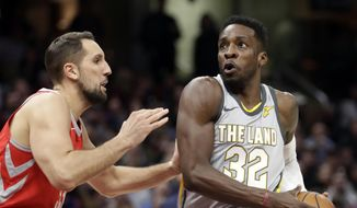 Cleveland Cavaliers' Jeff Green, right, drives against Houston Rockets' Ryan Anderson in the first half of an NBA basketball game, Saturday, Feb. 3, 2018, in Cleveland. (AP Photo/Tony Dejak) **FILE**