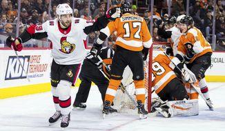 Ottawa Senators' Derick Brassard, left, celebrates after scoring past Philadelphia Flyers' Alex Lyon, right, during the first period of an NHL hockey game, Saturday, Feb. 3, 2018, in Philadelphia. (AP Photo/Chris Szagola)