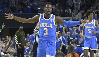 UCLA guard Aaron Holiday (3) gestures after making a three-point shot during the first half of an NCAA college basketball game against Southern California, Saturday, Feb. 3, 2018, in Los Angeles. (AP Photo/Michael Owen Baker)