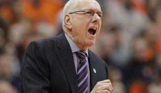 Syracuse head coach Jim Boeheim yells to his players in the first half an NCAA college basketball game against Virginia in Syracuse, N.Y., Saturday, Feb. 3, 2018. (AP Photo/Nick Lisi)