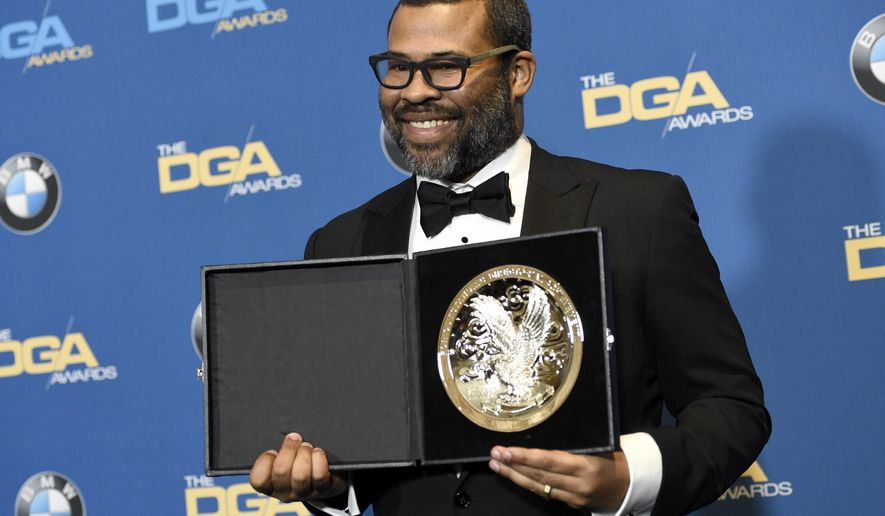 """Jordan Peele poses in the press room with a medallion honoring his nomination for outstanding directorial achievement in a feature film for """"Get Out"""" at the 70th annual Directors Guild of America Awards at The Beverly Hilton hotel on Saturday, Feb. 3, 2018, in Beverly Hills, Calif. (Photo by Chris Pizzello/Invision/AP)"""