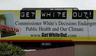 """This sign located near the headquarters of the Texas Commission on Environmental Quality as seen Tuesday, July 17, 2007, in Austin, Texas, calls for the removal of chairwoman Kathleen Hartnett White.  Tom """"Smitty"""" Smith, of the watchdog group, Public Citizen, that sponsors the billboard, says they are targeting her because of the quality of her decision making, which they say has been bad for the environment in Texas.  (AP Photo/Harry Cabluck)"""