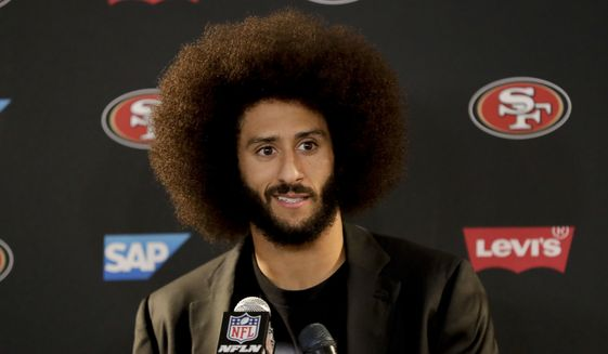In this Dec. 24, 2016, file photo, then-San Francisco 49ers quarterback Colin Kaepernick talks during a news conference after an NFL football game against the Los Angeles Rams. (AP Photo/Rick Scuteri, File)