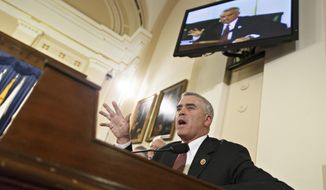 Rep. Brad Wenstrup, R-Ohio, a member of the House Committee on Veterans' Affairs, questions officials from the Department of Veterans Affairs about allegations of gross mismanagement and misconduct at VA hospitals possibly leading to patient deaths, on Capitol Hill in Washington, Wednesday, May 28, 2014. (AP Photo/J. Scott Applewhite)