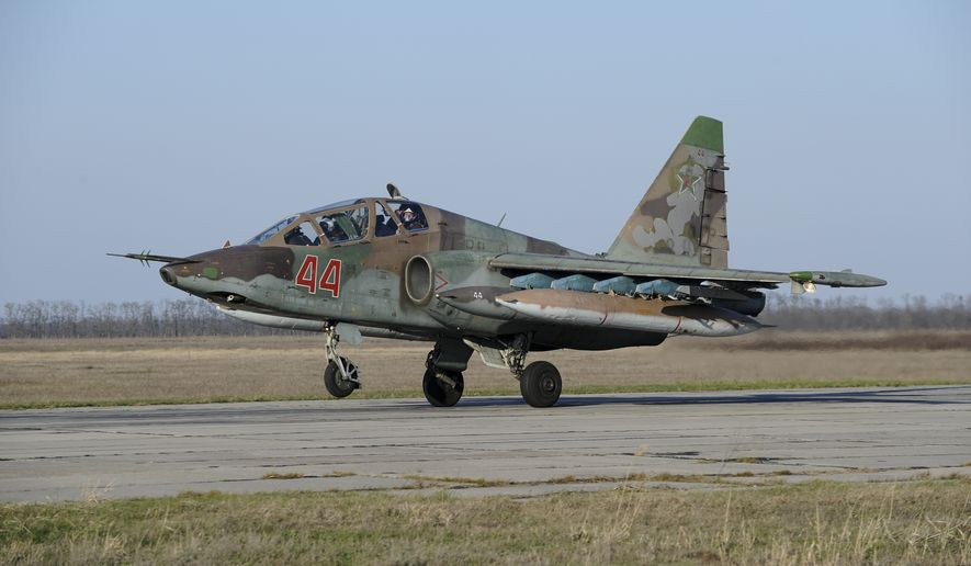 Russian Su-25 ground attack jet lands after return from Syria at a Russian air base in Primorsko-Akhtarsk, southern Russia, Wednesday, March 16, 2016. More Russian planes returned from Syria on Wednesday, two days after President Vladimir Putin ordered Russian military to withdraw most of its fighting forces from Syria, signaling an end to Russia's five-and-a-half month air campaign. (AP Photo)