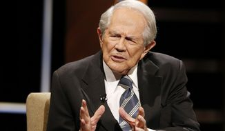 Rev. Pat Robertson gestures as he poses a question to Republican presidential candidate former Florida Gov. Jeb Bush during a Presidential candidate forum at Regent University in Virginia Beach, Va., Friday, Oct. 23, 2015.    (AP Photo/Steve Helber)