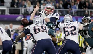 New England Patriots quarterback Tom Brady fumbles after being stripped by Philadelphia Eagles Brandon Graham in the fourth quarter at Super Bowl 52 on Sunday, February 4, 2018 in Minneapolis. (AP Photo/Gregory Payan)