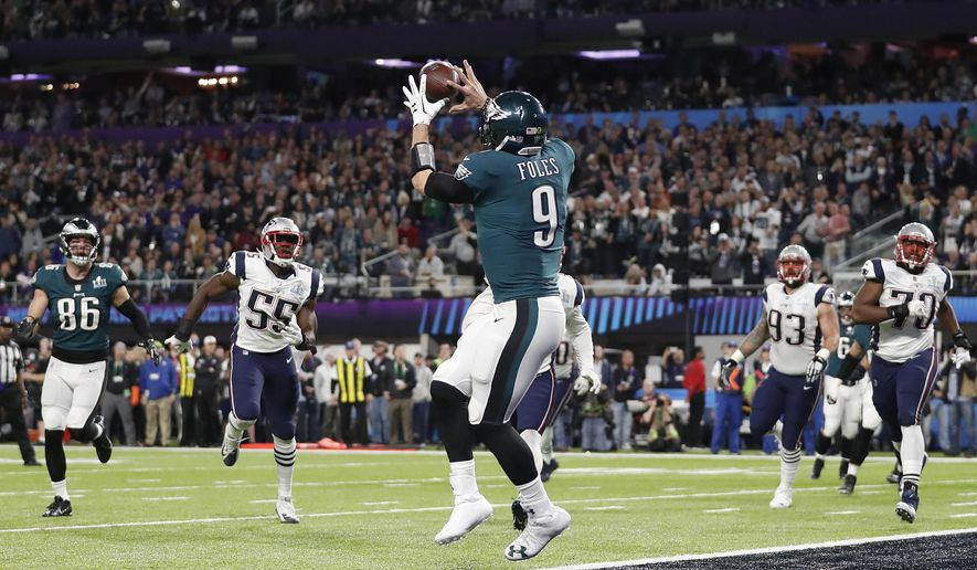 Philadelphia Eagles  Nick Foles catches a touchdown pass during the first  half of the NFL Super Bowl 52 football game against the New England  Patriots ... ea9c43c23