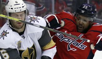 Vegas Golden Knights defenseman Colin Miller (6) takes a stick to the nose from Washington Capitals right wing Devante Smith-Pelly (25) in the second period of an NHL hockey game, Sunday, Feb. 4, 2018, in Washington. (AP Photo/Alex Brandon)