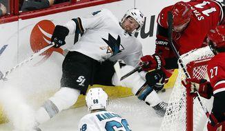 San Jose Sharks' Marc-Edouard Vlasic (44) collides with Carolina Hurricanes' Jordan Staal (11) during the third period of an NHL hockey game, Sunday, Feb. 4, 2018, in Raleigh, N.C. (AP Photo/Karl B DeBlaker)