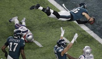 Philadelphia Eagles tight end Zach Ertz scores past New England Patriots free safety Devin McCourty during the second half of the NFL Super Bowl 52 football game Sunday, Feb. 4, 2018, in Minneapolis. (AP Photo/Eric Gay)