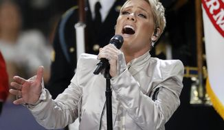Pink performs the national anthem before the NFL Super Bowl 52 football game between the Philadelphia Eagles and the New England Patriots Sunday, Feb. 4, 2018, in Minneapolis. (AP Photo/Matt York)