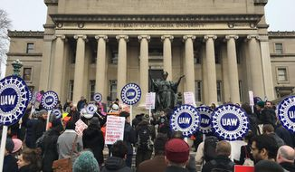 In this Feb. 1, 2018 photo, demonstrators advocate for a union at Columbia University in New York after the school announced earlier in the week that it won't bargain with the students who voted overwhelmingly for union representation more than a year ago. Union advocates say other universities are similarly declining to bargain or to agree to union elections, perhaps waiting for a more management-friendly NLRB to reverse its earlier ruling. (Nate Wagner via AP)