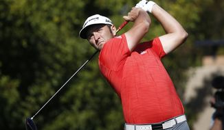 Jon Rahm, of Spain, tees off at the second hole during the final round of the Waste Management Phoenix Open golf tournament Sunday, Feb. 4, 2018, in Scottsdale, Ariz. (AP Photo/Ross D. Franklin)