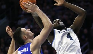 Villanova forward Eric Paschall (4) takes a shot over Seton Hall forward Sandro Mamukelashvili (23) during the first half of an NCAA college basketball game, Sunday, Feb. 4, 2018, in Philadelphia, Pa. (AP Photo/Laurence Kesterson)