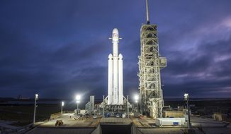 This Dec. 28, 2017 photo made available by SpaceX shows a Falcon Heavy rocket in Cape Canaveral, Fla. With more than 5 million pounds of liftoff thrust the Heavy will be capable of lifting super-size satellites into orbit and sending spacecraft to the moon, Mars and beyond. (SpaceX via AP)