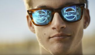 This photo provided by PepsiCo shows Presley Gerber in a scene from the company's Pepsi Super Bowl spot. For the 2018 Super Bowl, marketers are paying more than $5 million per 30-second spot to capture the attention of more than 110 million viewers. (PepsiCo via AP)