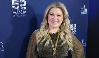 Kelly Clarkson appears at Nomadic Live at The Armory prior to the Super Bowl on Sunday, Feb. 4, 2018 in Minneapolis in this file photo.  (AP Photo/John Carucci) **FILE**