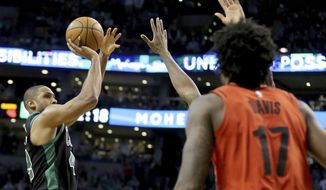Boston Celtics forward Al Horford (42) launches the winning shot during the second half of an NBA basketball game against the Portland Trail Blazers, Sunday, Feb. 4, 2018, in Boston. (AP Photo/Mary Schwalm)