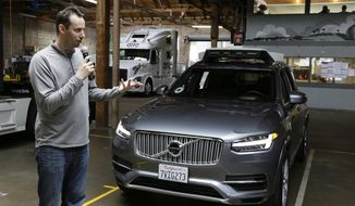 FILE - In this photo taken Tuesday, Dec. 13, 2016, file photo, Anthony Levandowski, then-head of Uber's self-driving program, speaks about their driverless car in San Francisco. A Google-bred pioneer in self-driving cars will collide with Uber's beleaguered ride-hailing service in a courtroom showdown Monday, Feb. 4, 2018, revolving around allegations of deceit, betrayal, espionage and a high-tech heist that tore apart one-time allies. (AP Photo/Eric Risberg, File)