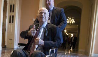 In this Dec. 1, 2017, file photo, Sen. John McCain, R-Ariz., leaves a closed-door session where Republican senators met on the GOP effort to overhaul the tax code, on Capitol Hill in Washington. (AP Photo/J. Scott Applewhite) ** FILE **