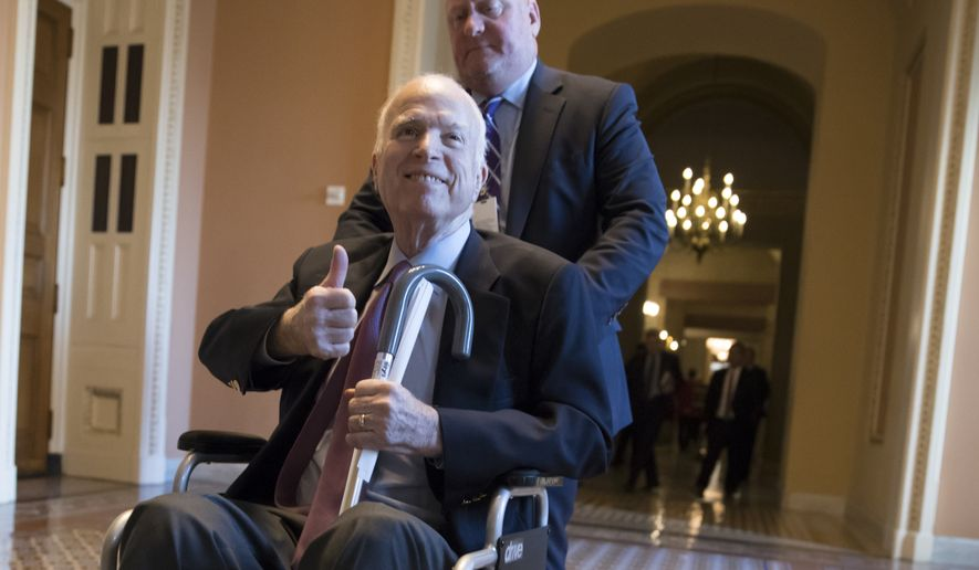 In this Dec. 1, 2017, file photo, Sen. John McCain, R-Ariz., leaves a closed-door session where Republican senators met on the GOP effort to overhaul the tax code, on Capitol Hill in Washington. (AP Photo/J. Scott Applewhite) ** FILE **