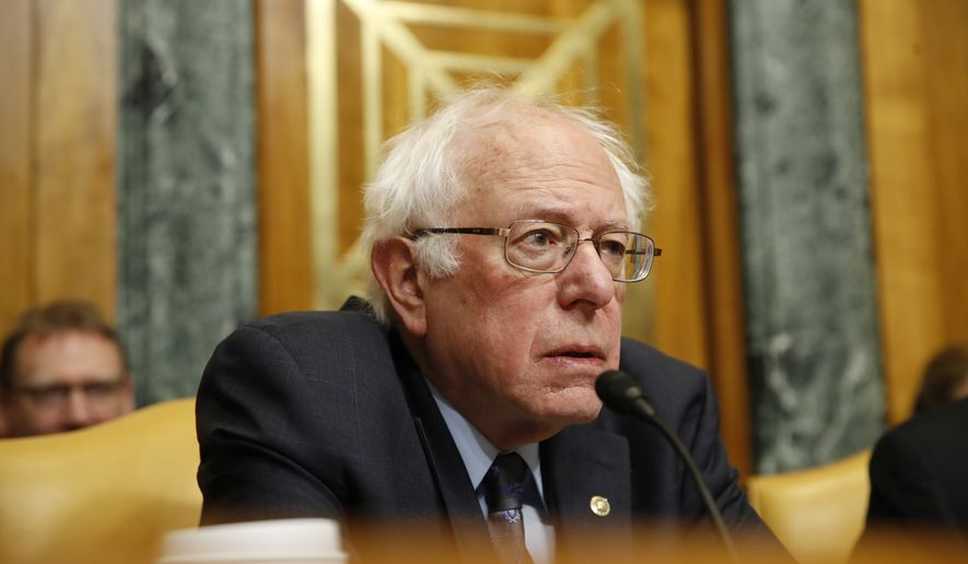 Senate Budget Committee Ranking Member Sen. Bernie Sanders, I-Vt., listens during a committee oversight hearing with testimony from Congressional Budget Office Director Keith Hall, Wednesday, Jan. 24, 2018, on Capitol Hill in Washington. (AP Photo/Jacquelyn Martin)