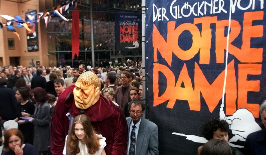 "An unidentified girl, in  front left, dressed as Esmeralda carries a dummy  representing Quasimodo as people go into the new concert hall at the 'Potsdamer Platz' in Berlin, Germany, Saturday June 5, 1999. The world premiere of the musical ""The Hunchback of Notre Dame"" will be staged here tonight. The musical is a co-production of the U.S. American Disney company and the German musical company Stella. It's the first Disney musical that will be  performed outside the USA. The play is performed by 44 artists from 15 nations and financed with a budget of 50 million German Marks (28 million USD) and thus is one of most expensive stage productions worldwide. (AP Photo/Jan Bauer)"