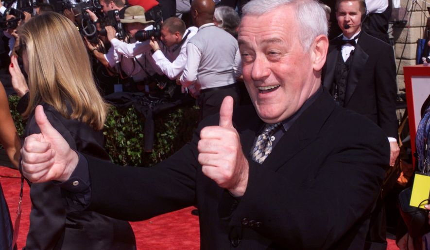 "John Mahoney gives a thumbs up to the crowd after arriving at the 51st Annual Primetime Emmy Awards at the Shrine Auditorium in Los Angeles, Sunday, Sept. 12, 1999. Mahoney is nominated for best supporting actor in a comedy series for ""Frasier."" (AP Photos/Mark J. Terrill)"