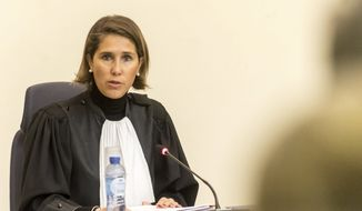 Belgian judge Marie-France Keutgen presides over the trial of Salah Abdeslam at the Brussels Justice Palace in Brussels on Monday, Feb. 5, 2018. Salah Abdeslam and Soufiane Ayari face trial for taking part in a shooting incident in Vorst, Belgium on March 15, 2016. The incident took place when six members of a Franco-Belgian research team investigating the attacks in Paris were conducting a search in an allegedly empty safe house of the terrorists and were attacked. (Danny Gys, Pool Photo via AP)