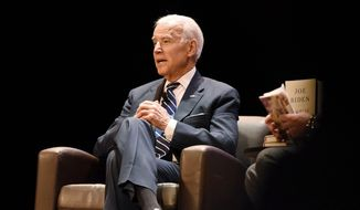 "Former Vice President Joe Biden is interviewed by sports writer, television analyst and University of Michigan graduate Adam Schefter at the Michigan Theater during his book tour in Ann Arbor, Mich., Monday evening, Feb. 5, 2018. The event was part of American Promise Tour for his memoir, ""Promise Me, Dad: A Year of Hope, Hardship, and Purpose."" (Tanya Moutzalias/The Ann Arbor News via AP)"