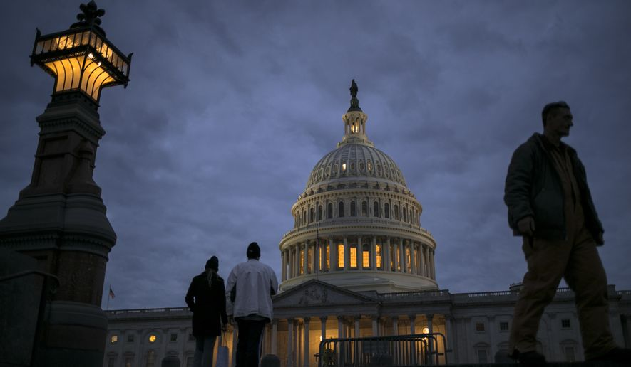 In this Jan. 21, 2018, file photo, lights illuminate the U.S. Capitol on second day of the federal shutdown as lawmakers negotiate behind closed doors in Washington. The era of trillion-dollar budget deficits is about make a comeback _ and a brewing budget deal hastened the arrival. Lawmakers are inching closer to a two-year, budget-busting spending pact that would give whopping budget increases to both the Pentagon and domestic programs have been inching closer to an agreement, according to aides and members of Congress. (AP Photo/J. Scott Applewhite, File)