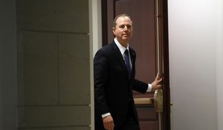 Rep. Adam Schiff, D-Calif., ranking member of the House Committee on Intelligence, arrives to speak with the media after a closed-door meeting of the House Intelligence Committee on Capitol Hill, Monday, Feb. 5, 2018 in Washington. (AP Photo/Alex Brandon)