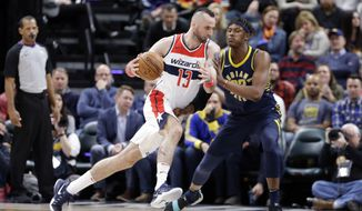 Washington Wizards center Marcin Gortat (13) drives around Indiana Pacers center Myles Turner (33) during the second half of an NBA basketball game in Indianapolis, Monday, Feb. 5, 2018. The Washington Wizards defeated the Pacers 111-102. (AP Photo/Michael Conroy)