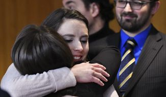 Rachael Denhollander hugs Det. Lt. Andrea Munford Monday, Feb. 5, 2018, after the third and final day of sentencing in Eaton County Court in Charlotte, Mich., where Nassar was sentenced on three counts of sexual assault.  (Matthew Dae Smith/Lansing State Journal via AP)