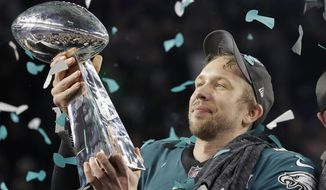 Philadelphia Eagles' Nick Foles holds up the Vince Lombardi Trophy after the NFL Super Bowl 52 football game against the New England Patriots, Sunday, Feb. 4, 2018, in Minneapolis. The Eagles won 41-33. (AP Photo/Matt Slocum) **FILE**